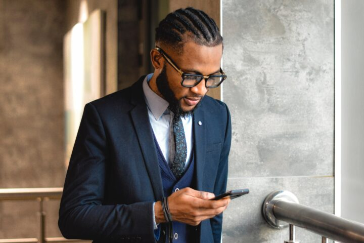 a man in a suit looking at his phone